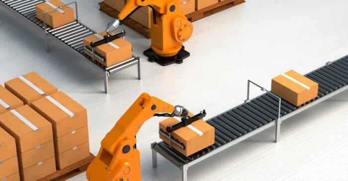 warehouse with robot arms packaging boxes